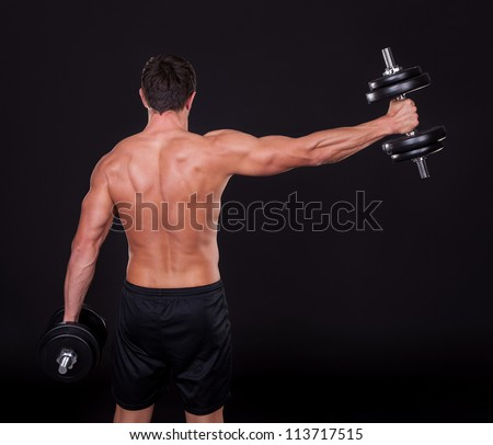 Young Man Exercising With Weightlift Isolated On Black Background - stock photo