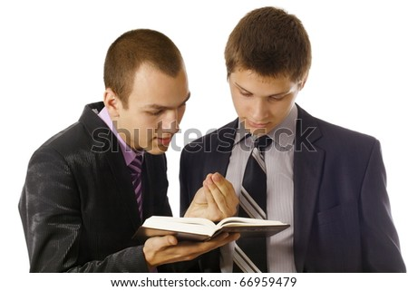 Young man explaining the Gospel to other young man - stock photo