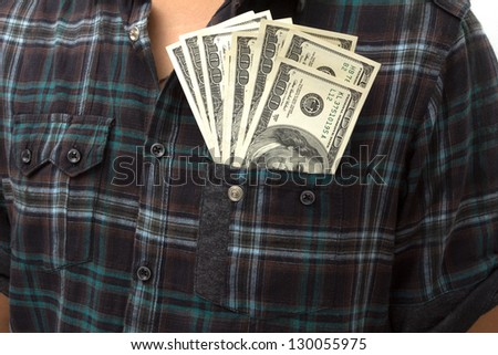 Young man extracting wearing a shirt and necktie with dollar in his front pocket. - stock photo