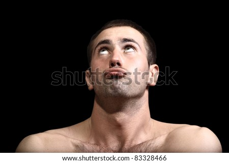 young man face expressions over black background