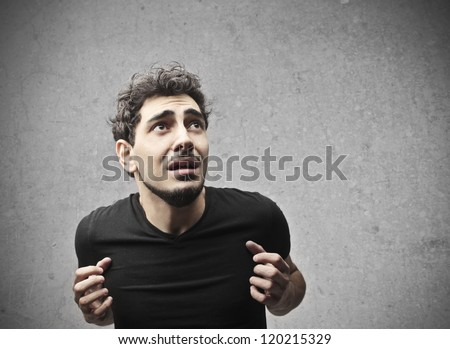 Young man feeling judged by someone - stock photo