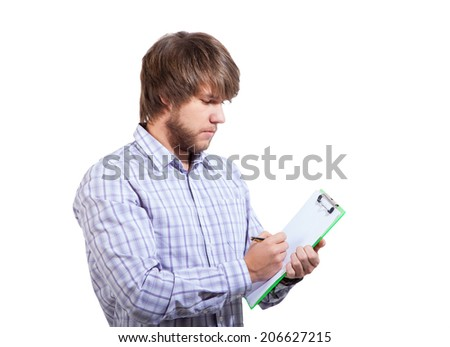 young man filling out a survey isolated on white - stock photo