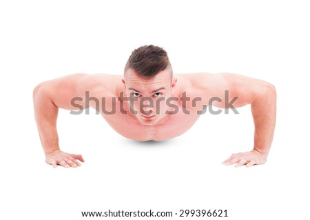 Young man fitness instructor making push ups isolated on white background