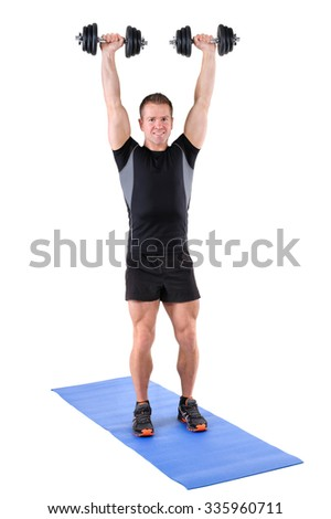 young man fitness instructor shows finishing position of standing dumbbell shoulder press, isolated on white - stock photo