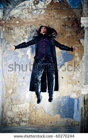 Young man flying - stock photo