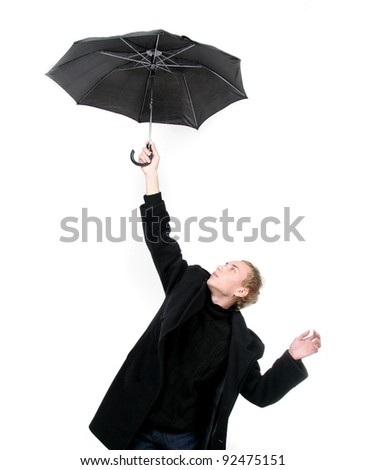young man flying away with umbrella over white - stock photo