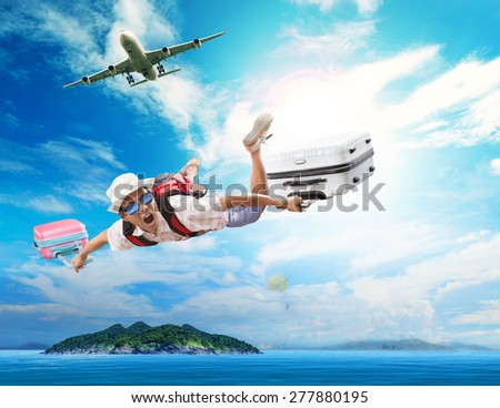 young man flying from passenger plane to natural destination island on blue ocean with happiness face emotion use for people traveling on vacation holiday in summer season  - stock photo