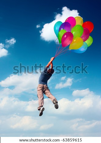 Young man flying in blue sky holding group of colored balloons. Balloons is illustration - stock photo