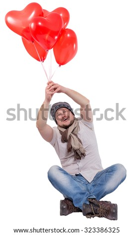 Young man flying on balloons isolated on white background - stock photo
