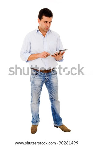 Young man full body using a tablet computer against white background - stock photo
