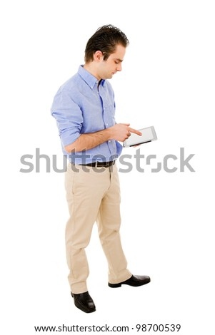 Young man full body using a tablet computer against white background