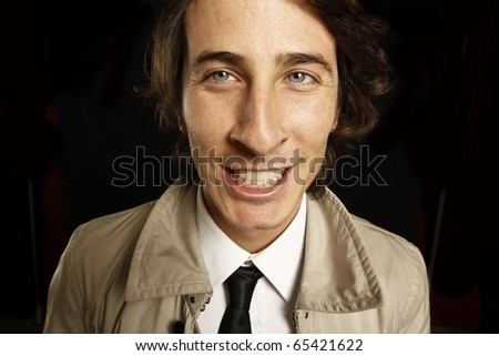 young  man funny face expression - stock photo