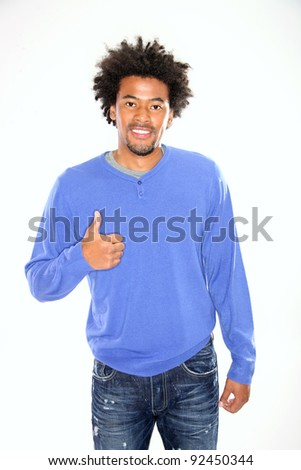 Young man gesturing thumb up on white background - stock photo