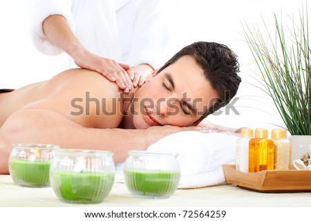 young man getting spa massage - stock photo