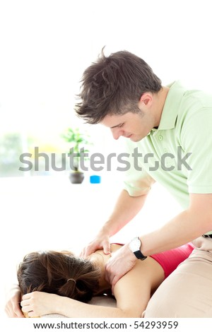 Young man giving a back massage in a health center - stock photo
