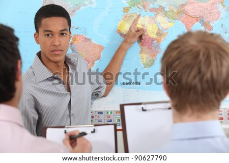 Young man giving a business presentation - stock photo