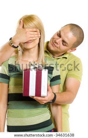 young man giving a present to his girlfriend