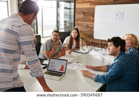 Young Man Giving Business Presentation On Stock Photo 390349687