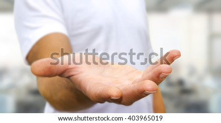 Young man giving empty hand on office background