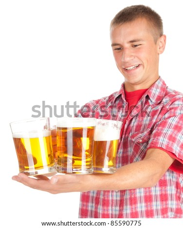 young man giving mugs of beer, white background - stock photo