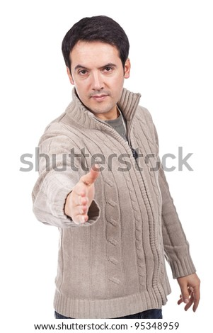 young man giving you a hand shake - stock photo