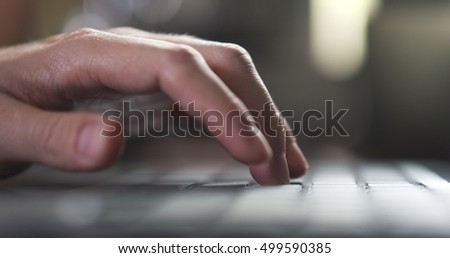 young man hand using notebook in cafe or home very shallow focus