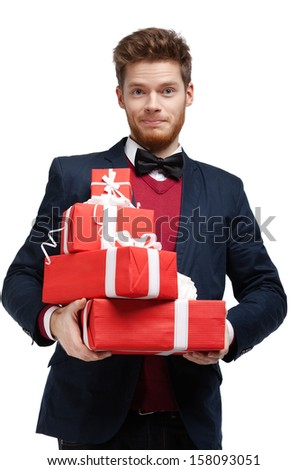 Young man hands a lot of Christmas presents, isolated on white - stock photo