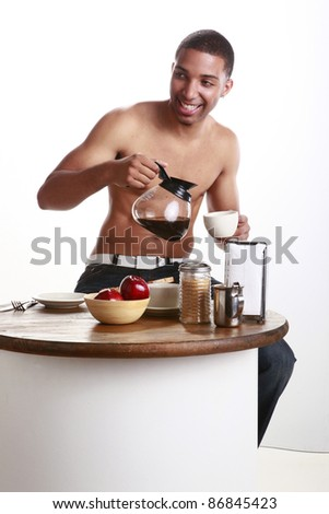 Young man has a cup of coffee - stock photo