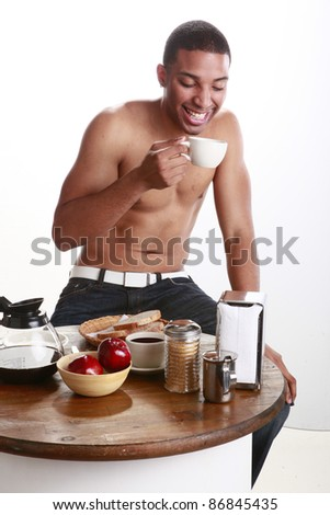Young man has a cup of coffee