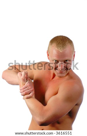 young  man has strained muscles of  trunk and looks in  camera