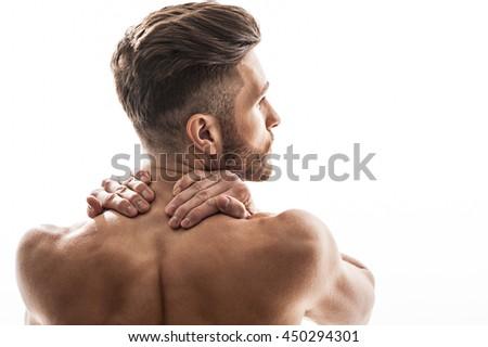 Young man has terrible neckache - stock photo