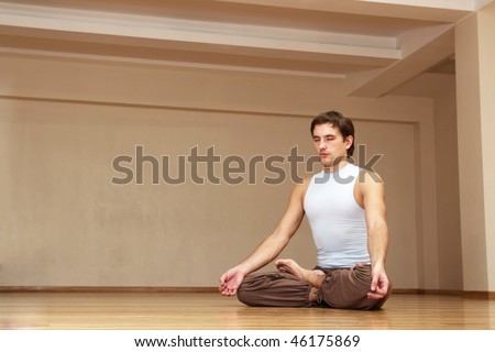 young man have a meditation alone indoor - stock photo