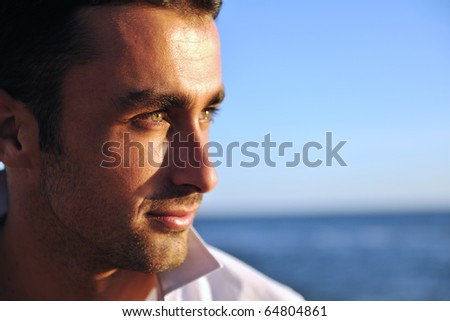 young man have good time and relax at beautifu beach at seaside - stock photo