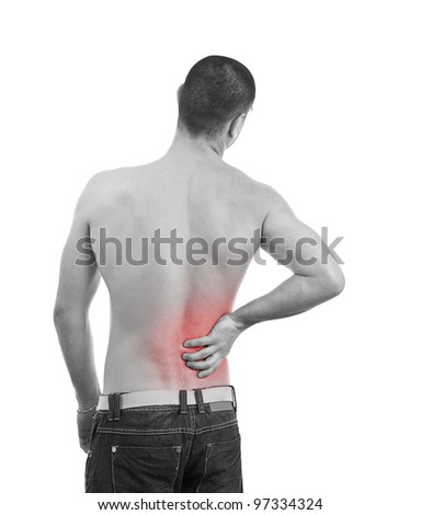 Young man having a Back pain, monochrome photo with red as a symbol for the hardening - stock photo