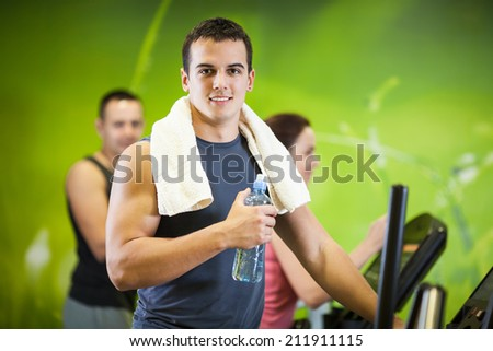 Young man having a break in the gym - stock photo
