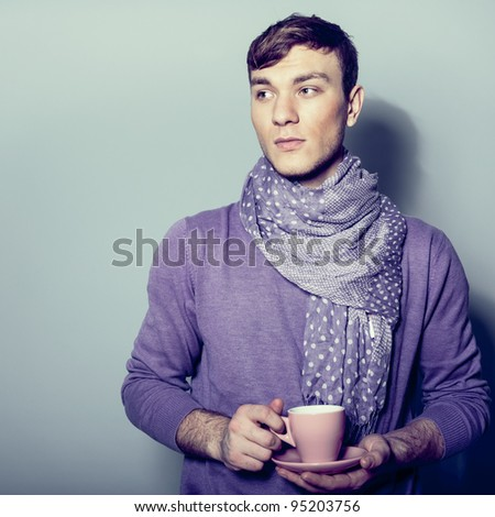 young man having a cup of coffee - stock photo