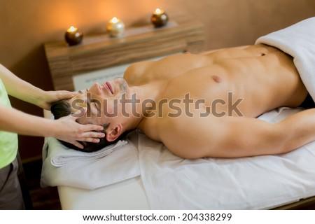 Young man having a facial massage - stock photo