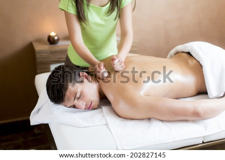 Young man having a massage - stock photo