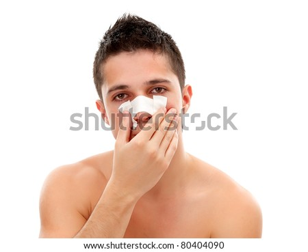 Young man having a nasal bandage, isolated on white background - stock photo