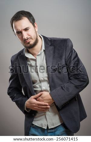 Young man having a stomach ache  - stock photo