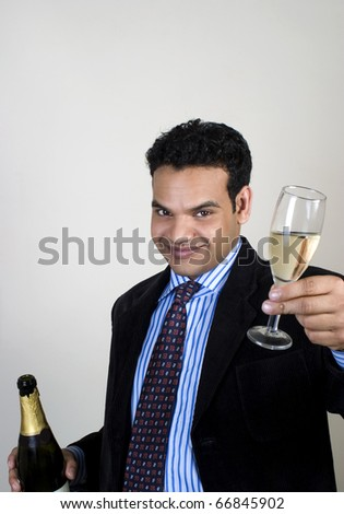 young man having fun in a party, toasting - stock photo