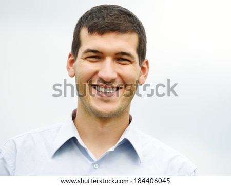 Young man having happy time in nature with copy space - stock photo