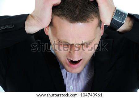 Young man having headache - stock photo