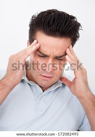 Young Man Having Headache Over White Background
