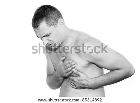 Young man having heart attack - stock photo