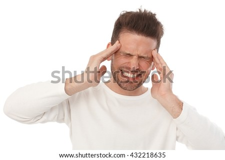 Young man having horrible headache, painful facial expression. - stock photo