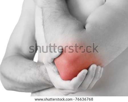 young man having pain in his elbow - sports injury - stock photo