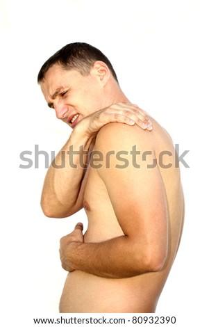 Young man having shoulder pain - stock photo