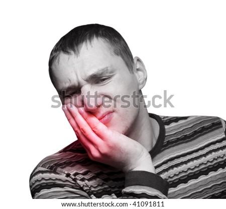 Young man having teeth pain - stock photo