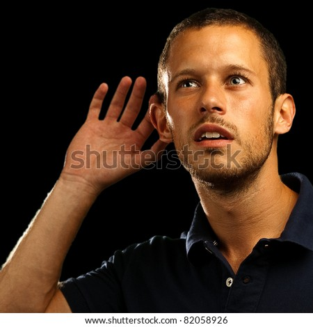 young man hearing sounds on white background - stock photo